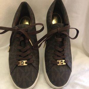 Michael Kors low top brown sneakers.